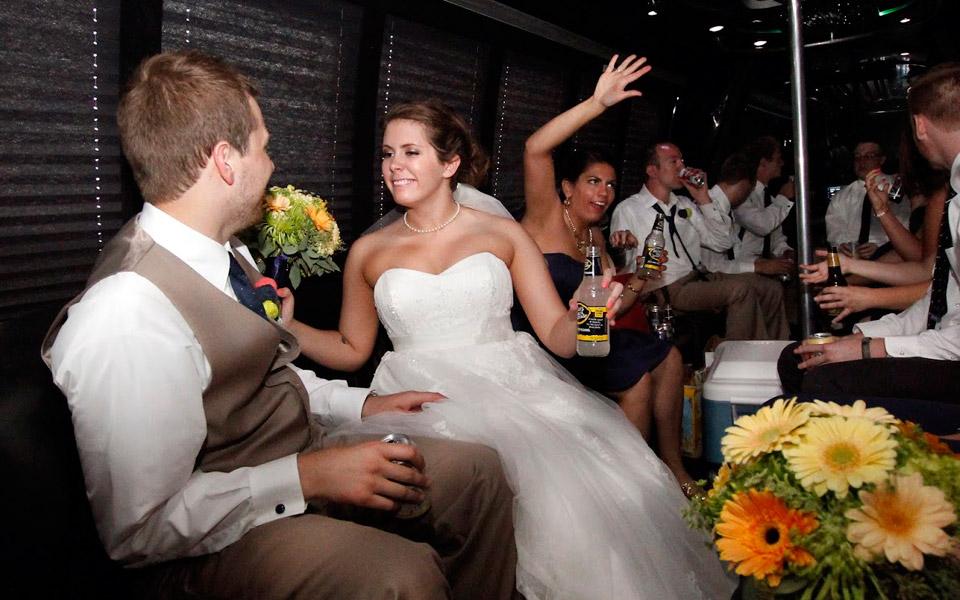 Bride having fun in limo bus