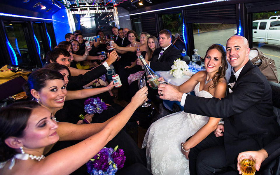 Wedding Party inside limo Bus