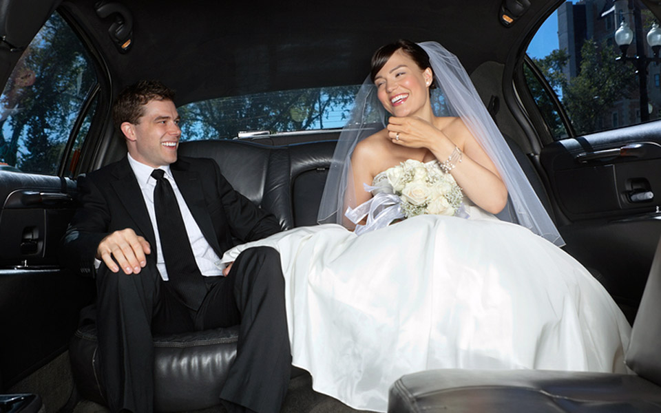 Bride And Groom Smiling Limo