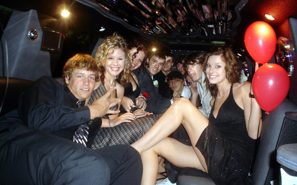 Prom students riding in limo