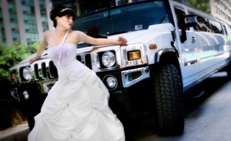 Bride in front of Hummer Limousine